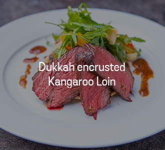 Kangaroo Dukkah encrusted fillet with caramelized onion & mushroom tart tatin, citrus & rocket salad and balsamic glaze (gf)